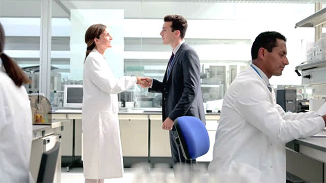 Scientist and businessman shake hands